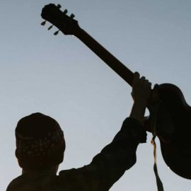 RockmusicRaider - Man with raised guitar - Tanagra wins Trademark Dispute